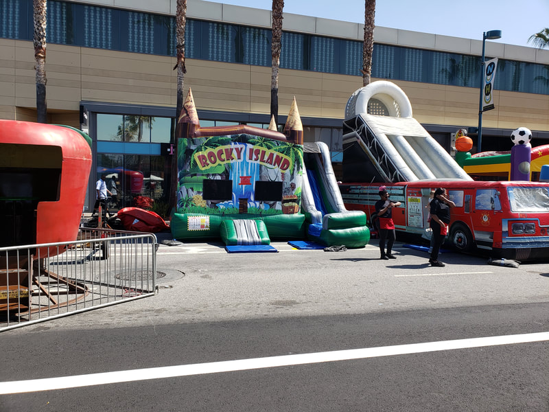 Inflatables and Rides at the Vegan Street Fair.
