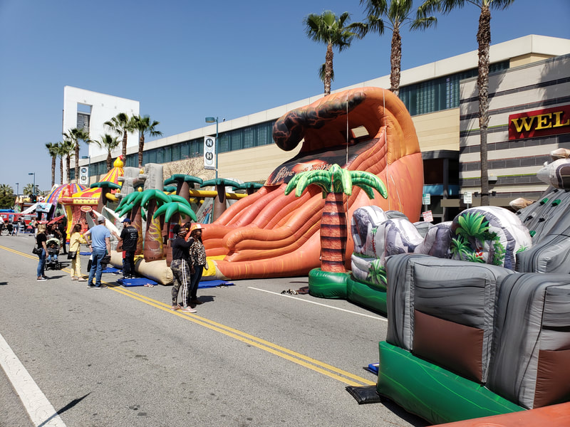 Inflatable slides, bouncers and playcenters.