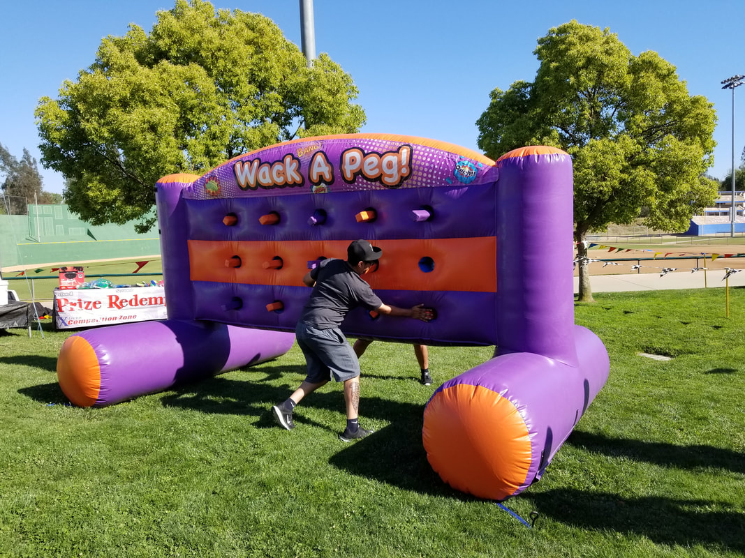 Whack A Peg Inflatable Games for Company Picnics and Corporate Events